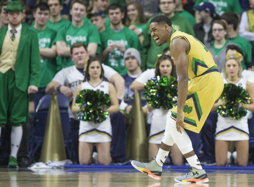 Notre Dame's Demetrius Jackson (11) grimaces in pain before leaving the court with an injury during the first half of an NCAA college basketball game against Boston College, Saturday, Jan. 23, 2016, in South Bend, Ind. (AP Photo/Robert Franklin)