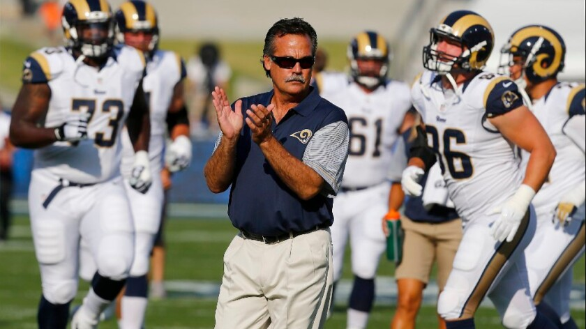 Rams Coach Jeff Fisher watches his team warm up before a preseason game against the Kansas City Chiefs at the Coliseum on Aug. 20.