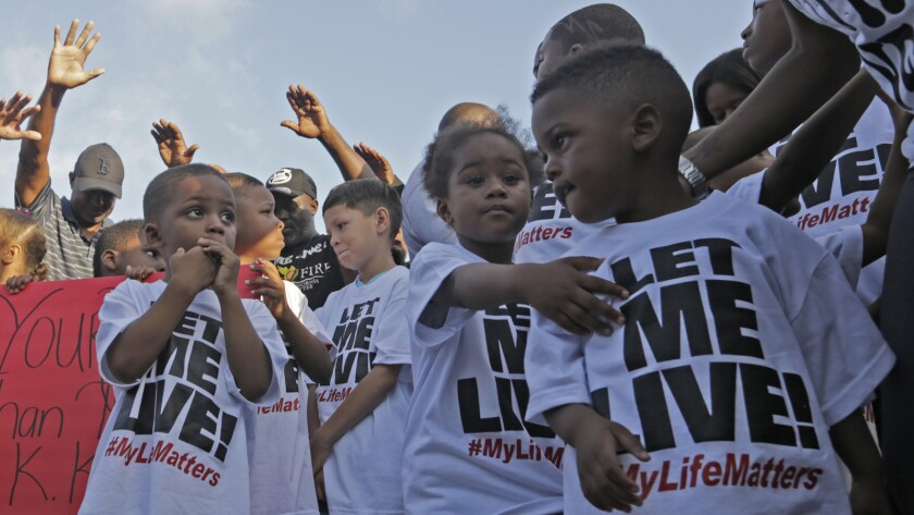 """Children take part in a """"Let us Live"""" peace rally in South Los Angeles earlier this week."""