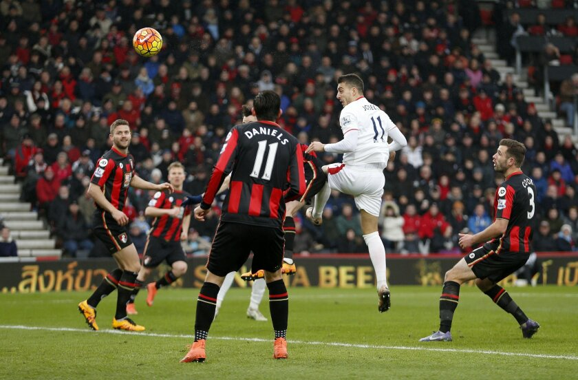 Stoke City's Joselu, second right, scores against Bournemouth during the English Premier League soccer match at the Vitality Stadium, Bournemouth, England, Saturday Feb. 13, 2016. (Steve Paston/PA via AP) UNITED KINGDOM OUT