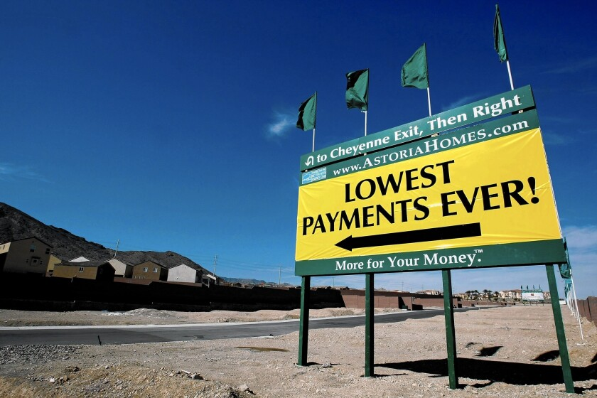 As the housing market heated up in the mid-2000s, Wall Street banks rushed to market high-yielding, mortgage-related securities, each of which required a rating on their credit quality by one of the three firms that dominated the market. Above, a sign advertising a new housing development in Las Vegas in 2009.