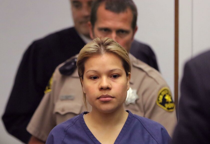 Esteysi Sanchez enter the courtroom at the Vista Courthouse for her arraignment. She's suspected of killing a man while driving drunk. Behind her in black is Judge James Mangione.