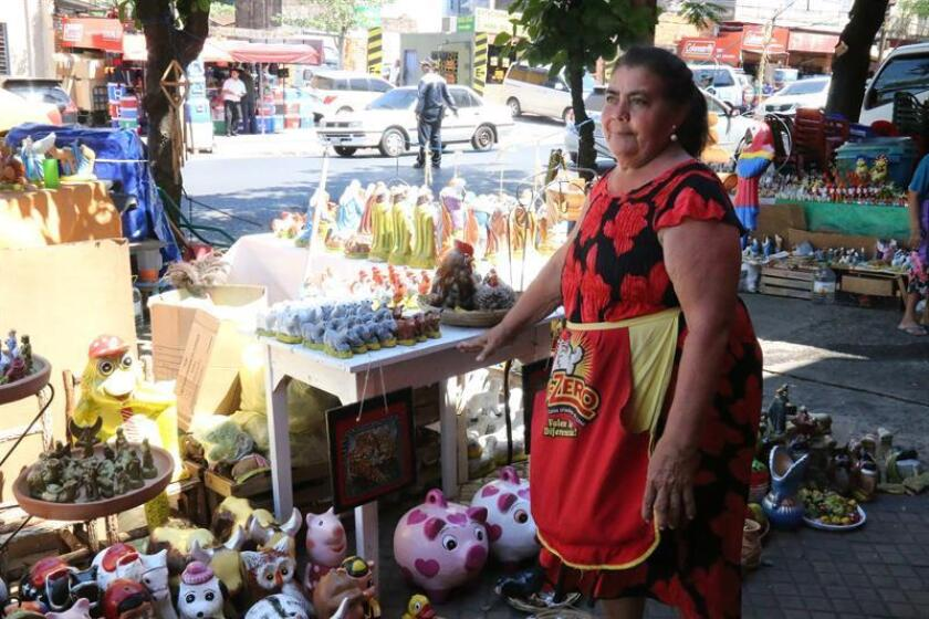 Saleswoman Magdalena Torres offers on Dec. 18, 2018, her Christmas products in Asuncion's Market 4, where the aroma of coconut blossom, the most typical of Paraguay's Christmas fragrances, is enjoyed by shoppers throughout this festive season. EFE-EPA/Alejandro R. Otero