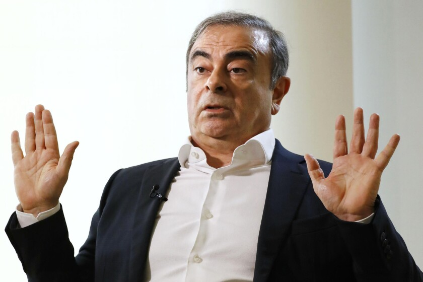 Former Nissan Chairman Carlos Ghosn speaks to Japanese media during a January interview in Beirut.