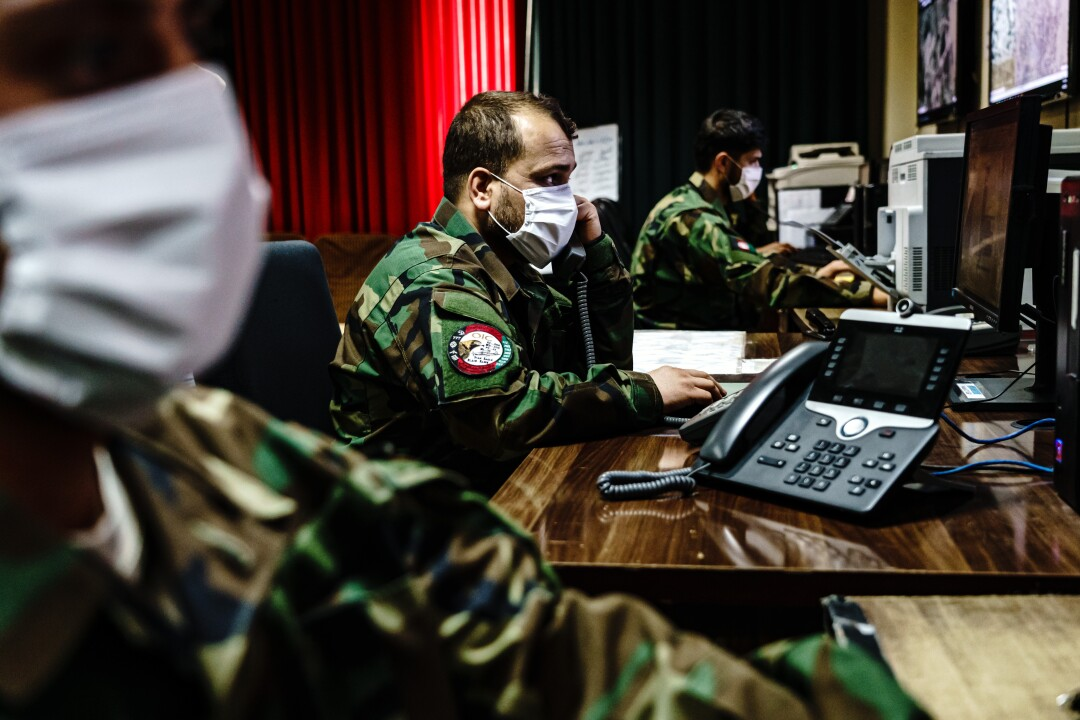 Intelligence officers look at monitors
