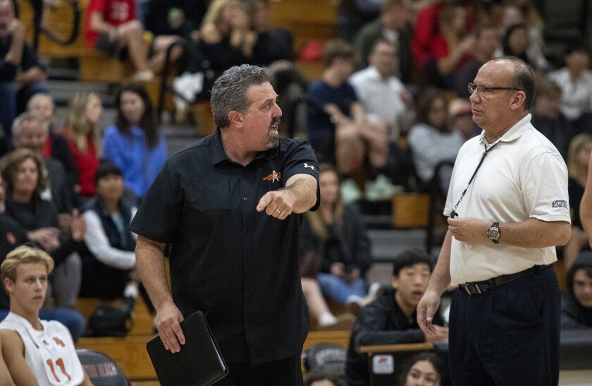Huntington Beach boys' volleyball coach Craig Pazanti argues a call with a referee in February 2019.
