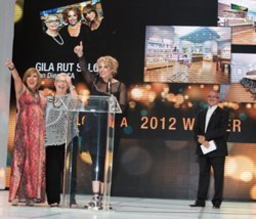 Left to right, Gila Rut Aveda Salon owners Karla Lopez-Martinez, Carol Davis and Keri Davis accepting the 'Salon MBA' Award.