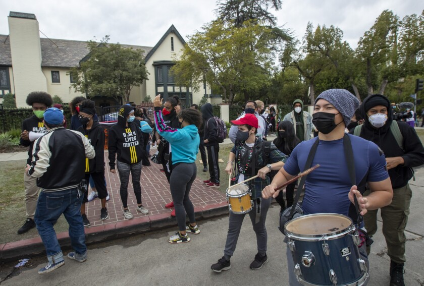 Demonstrators march in front of Getty House, the residence of Los Angeles Mayor Eric Garcetti, in December.