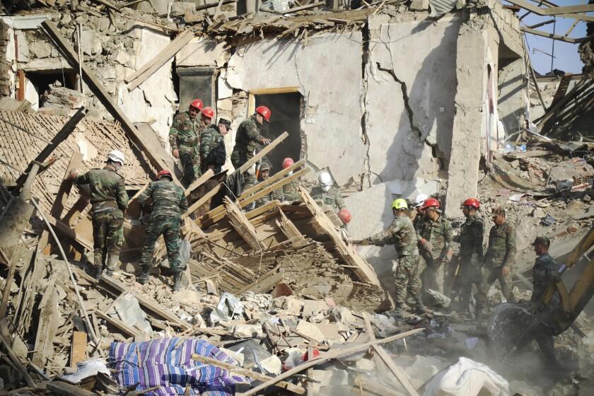 Rescuers in Ganja, Azerbaijan, after alleged shelling by Armenian artillery