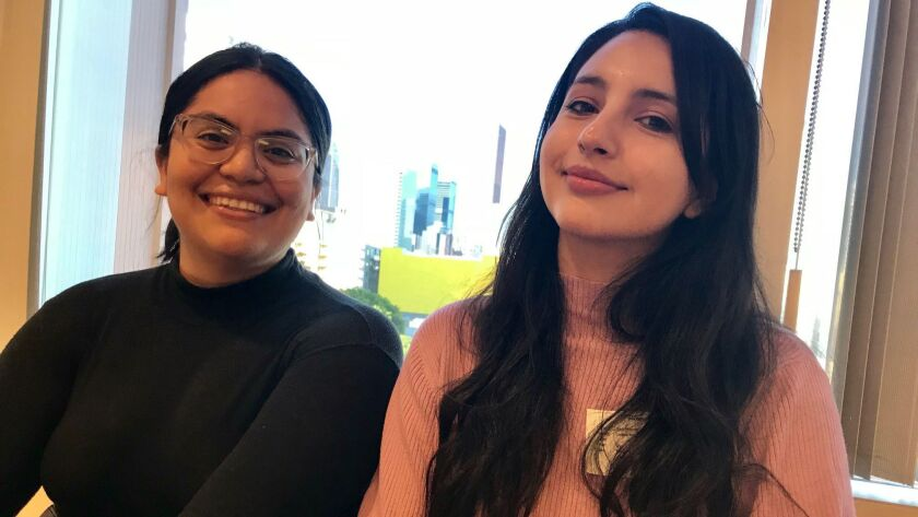 """Katherine """"Kat"""" Trejo,24, a young college graduate and L.A. Unified alumna, left, helps to mento"""