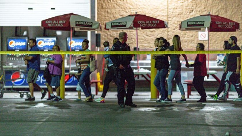 Customers leave the Costco in Corona after a shooting involving an off-duty LAPD officer last June.