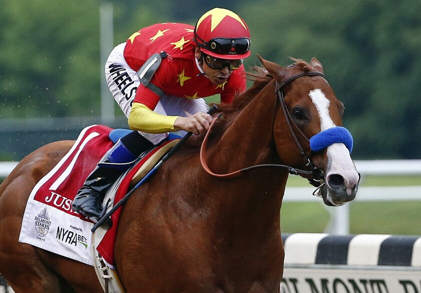 FILE - In this June 9, 2018, file photo, Justify (1), with jockey Mike Smith up, crosses the finish line to win the 150th running of the Belmont Stakes horse race and the Triple Crown in Elmont, N.Y. Smith will handle Authentic for the first time in Saturday's, July 18, 2020, Haskell Stakes at Monmouth Park.(AP Photo/Peter Morgan, File