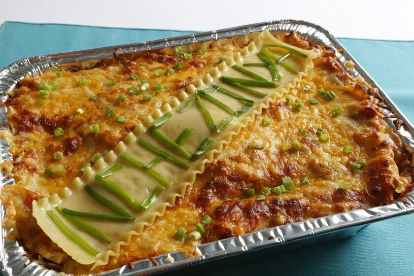 Inchezonya is a mash-up of Mexican enchilada casserole and lasagna. The banner on top makes it party-worthy. Recipe: Inchezonya