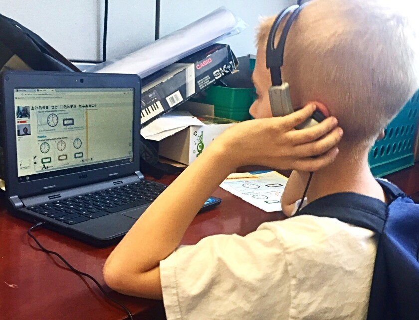 A child uses a laptop donated by Mesa Water District.