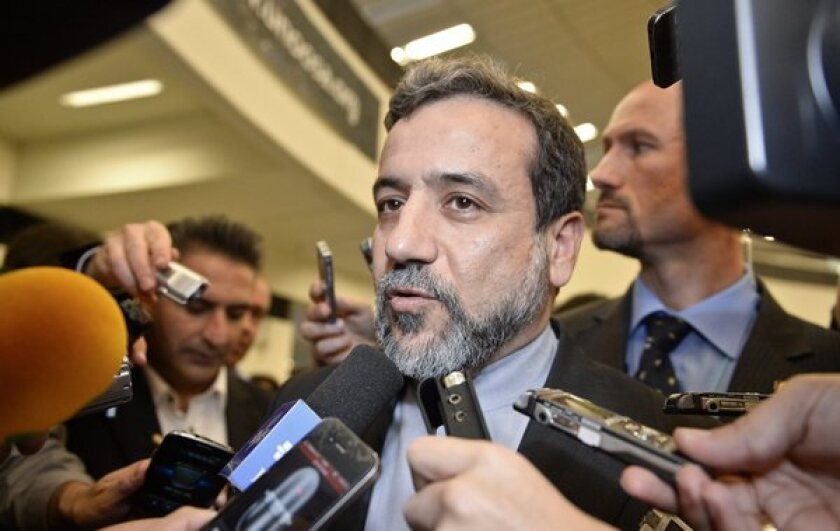 Iranian nuclear negotiator Abbas Araqchi talks to reporters after a meeting with International Atomic Energy Agency officials in Vienna.