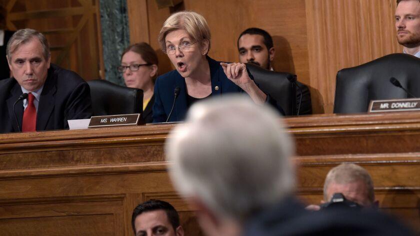 Senate Banking Committee member Sen. Elizabeth Warren, D-Mass., center, questions Wells Fargo Chief