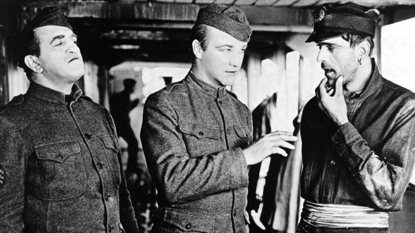 "Louis Wolheim, left, William Boyd and Boris Karloff in ""Two Arabian Knights."""
