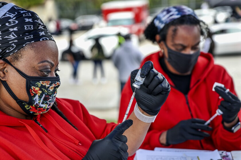 Nurse Brandee Hassell, left, and Dr. Sharon Smith, members of the San Diego Black Nurses Association,.