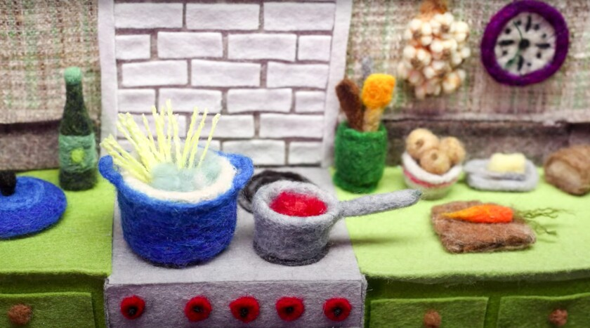 Screenshot from a colorful stop-motion video of cooking a pasta meal made from wool on Andrea Love's YouTube channel.