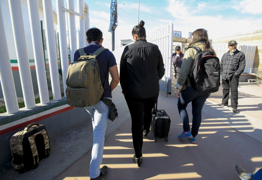 At the PedWest port of entry in Tijuana, Margaret Cargioli (r), managing attorney for Immigrant Defenders Law Center in San Diego walks with Jose, 20 (l) and Casey Revkin (r) director at Immigrant Families Together towards the U.S. port of entry in San Ysidro. After not being allowed to cross on December 6th, Cargioli on Tuesday, December 10, 2019 tried again with Jose and on her second attempt was allowed to cross into the U.S. with her Jose.
