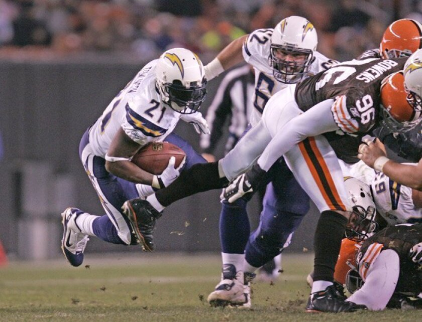 LaDainian Tomlinson goes airborne for two of his 64 yards. Tomlinson moved from 10th to eighth in career rushing yards with 12,321.