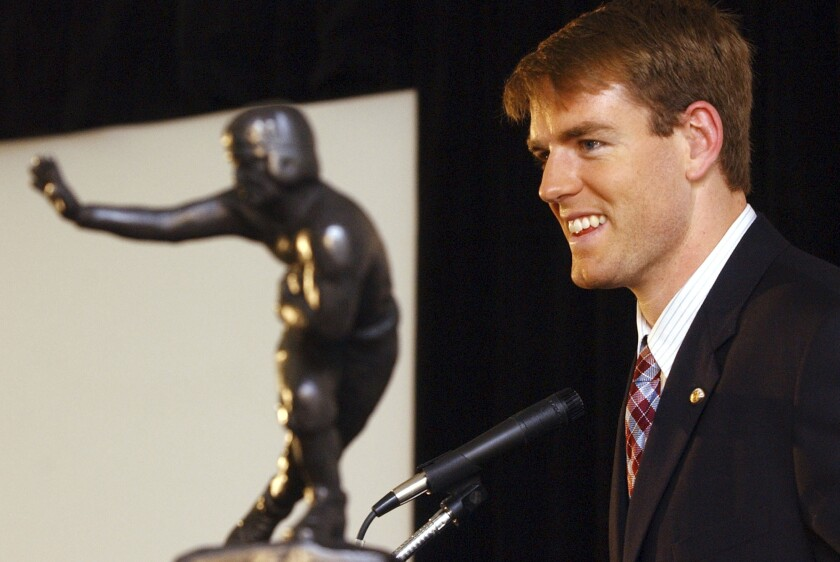 USC quarterback Carson Palmer poses with the Heisman Trophy after winning the award in 2002.