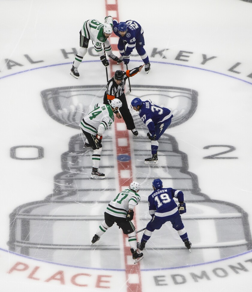 Players from the Dallas Stars and the Tampa Bay Lightning line up for the face off during first-period NHL Stanley Cup finals hockey action in Edmonton, Alberta, Saturday, Sept. 19, 2020. (Jason Franson/The Canadian Press via AP)