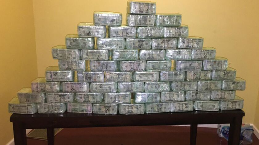 Some of the $6 million dollars seized as part of an investigation into money laundering that resulted in forty defendants charged in San Diego with conspiring to launder millions of dollars in drug