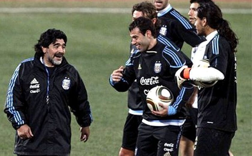 Argentina coach Diego Maradona has a light moment with his team during practice Wednesday, June 30. The Argentines play Germany Saturday in a World Cup quarterfinal.