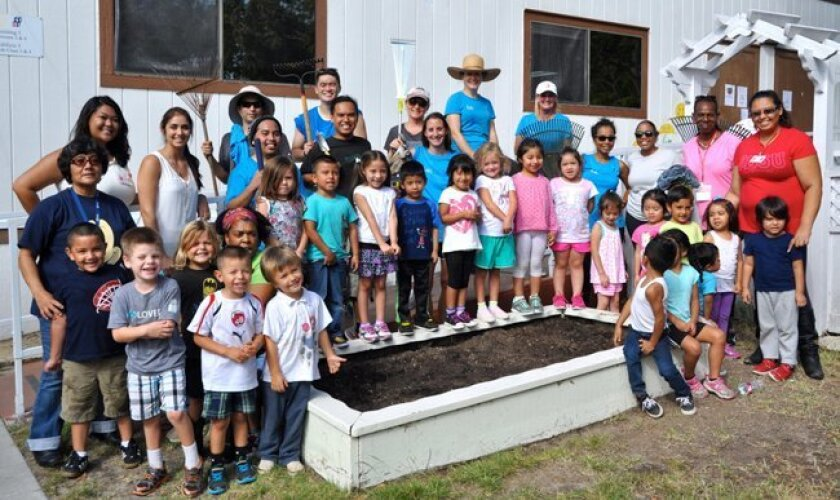 Employees from ecoATM volunteered recently renovating garden boxes at the Easter Seals Child Development Center in Solana Beach. Courtesy photo