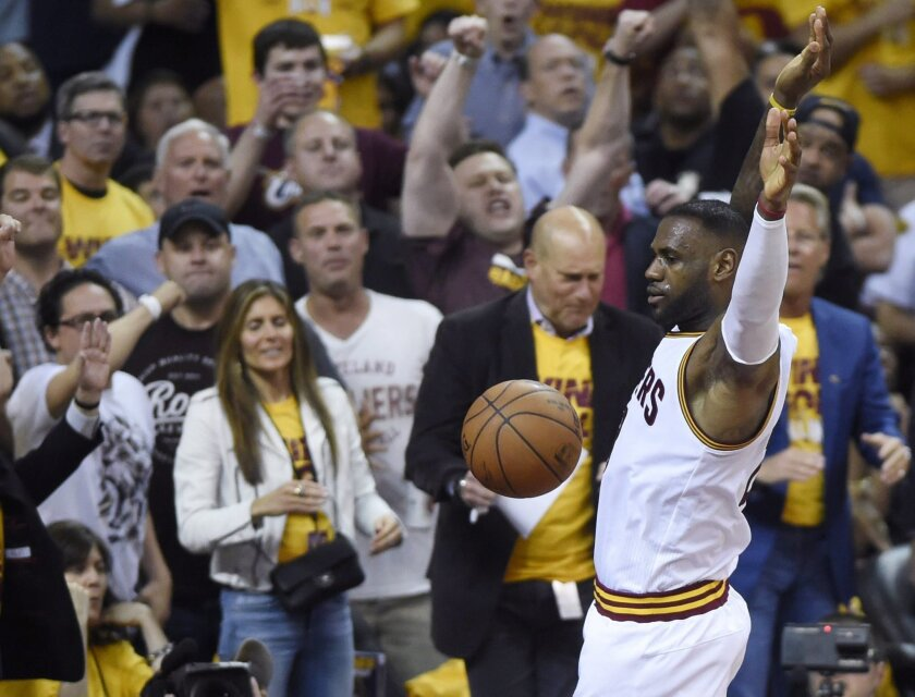 Cleveland Cavaliers forward LeBron James celebrates a dunk against the Toronto Raptors during the first half of Game 5 of the NBA basketball Eastern Conference finals, Wednesday, May 25, 2016, in Cleveland. (Frank Gunn/The Canadian Press via AP)