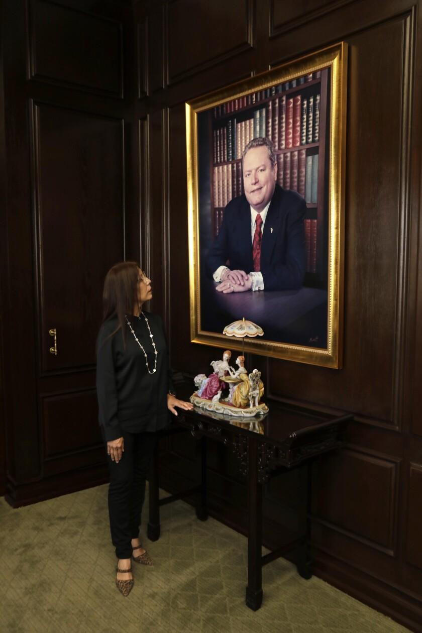 Liz Flynt looks at a portrait of her late husband, publisher Hustler Larry Flynt, in his Beverly Hills office.