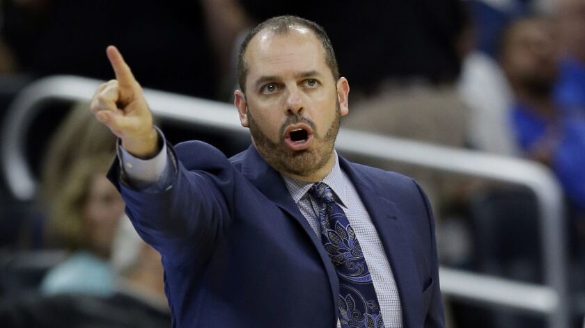 Orlando Magic head coach Frank Vogel directs his player against the Denver Nuggets during the second