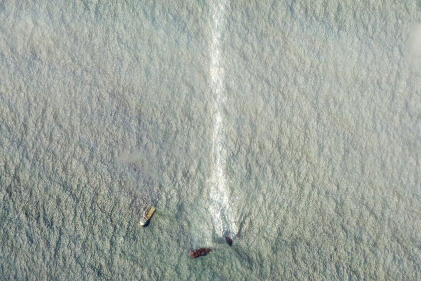This satellite image provided by Planet Labs Inc. shows a sinking ship, the Singapore-flagged MV X-Press Pearl, with the oil leak line in the Laccadive Sea off Sri Lanka Monday, June 7, 2021. (Planet Labs Inc. via AP)