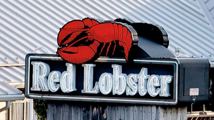 Darden said it would make its Red Lobster chain a separate business and stop expansion at Olive Garden
