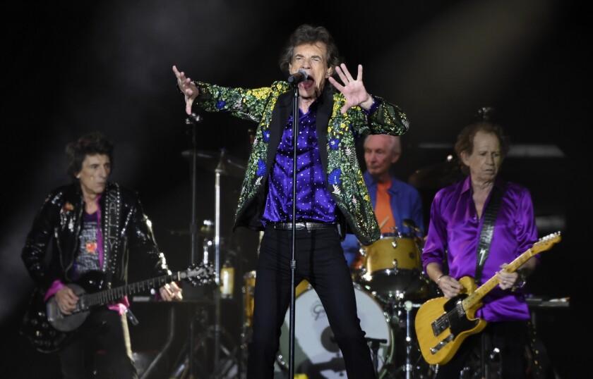 Mick Jagger, en el centro, y sus compañeros de los Rolling Stones Ron Wood, Charlie Watts y Keith Richards