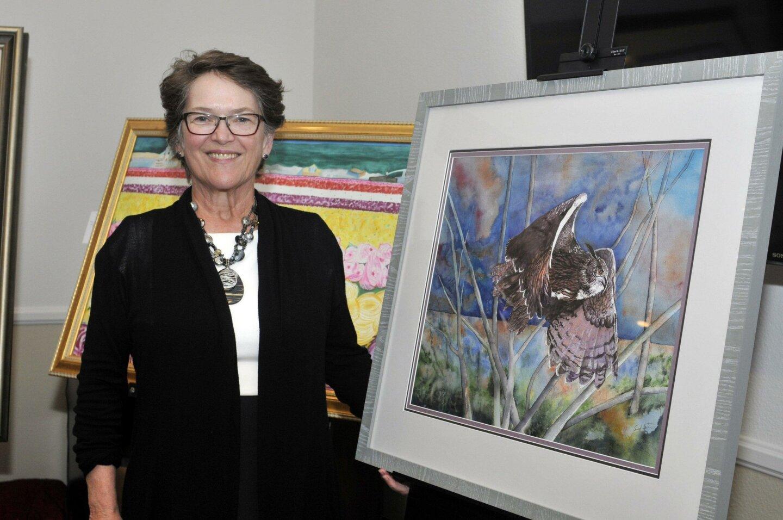 """Artist Carol Hartner with """"Owl in Flight"""""""