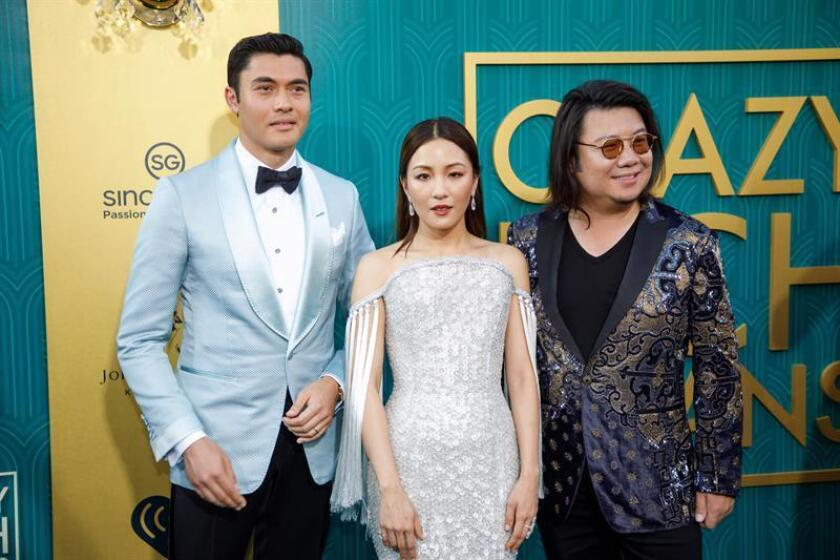 British-Malaysian actor/cast member Henry Golding (L-R) US actress/cast member Constance Wu and US book author/executive producer Kevin Kwan attend the US premiere of 'Crazy Rich Asians' at the TCL Chinese Theatre IMAX in Hollywood, Los Angeles, California, USA, 07 August 2018. EFE/EPA/FILE ]