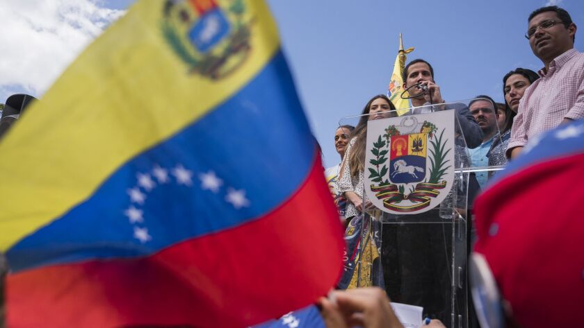 People gather during a citizen's assembly to support Juan Guaido in Caracas.
