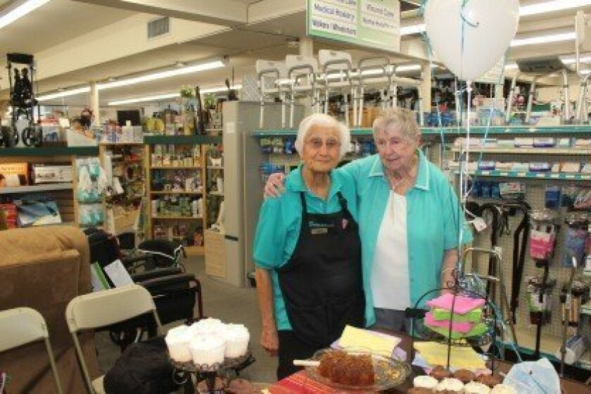 Burns Drugs employees Clem Bunch, 92, and Betty Clifford, 91. Clifford retired last week after 19 years working there