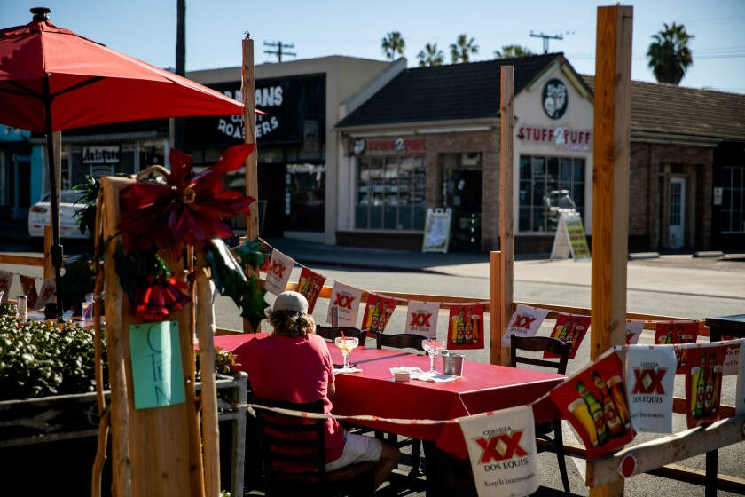 Diners take in a meal on the patio at Ortega's Cocina in Ocean Beach in December.