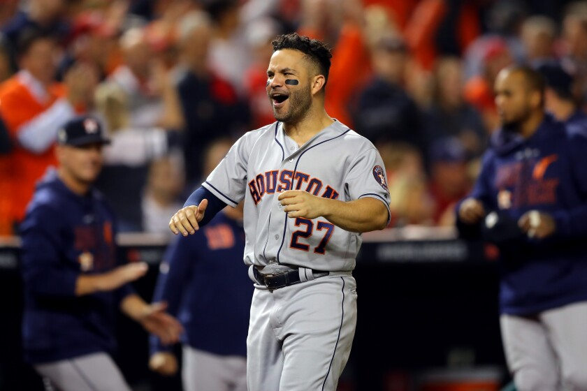 The Astros' Jose Altuve celebrates Robinson Chirinos' sixth-inning homer during Game 3 of the World Series on Oct. 25, 2019.