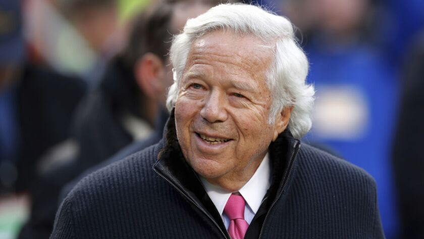 FILE - In this Jan. 20, 2019, file photo, New England Patriots owner Robert Kraft walks on the field