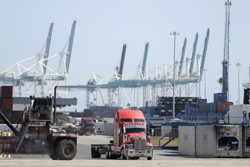 A truck leaves the docks at PortMiami