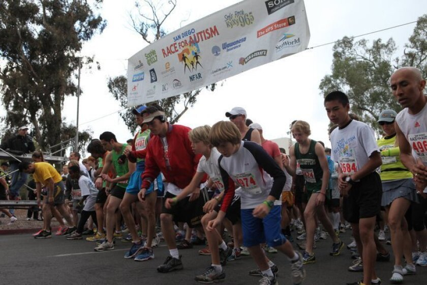 Erik Weber (red jacket) gets ready to take off at the starting line of the 2011 Race for Autism in Balboa Park