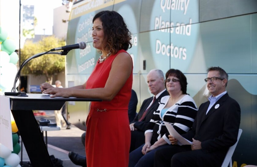 Leticia Cazares of the San Ysidro Health Center spoke Friday during Covered California's launch of its open-enrollment awareness campaign at Scripps Mercy Hospital in Hillcrest. In the background were (from left) Chris Van Gorder, CEO of the Scripps Health network; Kelly Hartmann, an enrollee in the Covered California health exchange; Peter Lee, executive director of Covered California. / photo by Nancee Lewis * U-T