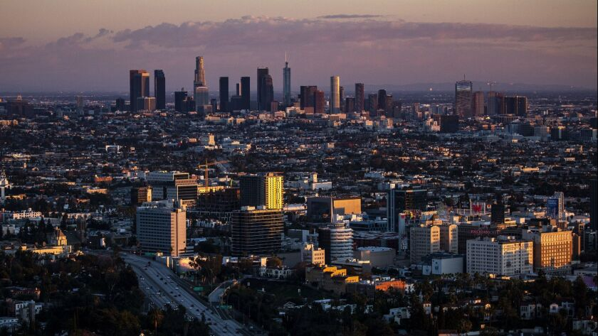 LOS ANGELES, CALIF. - DECEMBER 25: The Downton Los Angeles skyline sits as a backdop to the Hollywoo