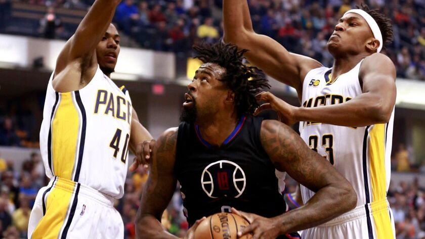 Clippers center DeAndre Jordan attempts to shoot between Indiana's Glenn Robinson III, left, and Myles Turner on Nov. 27.