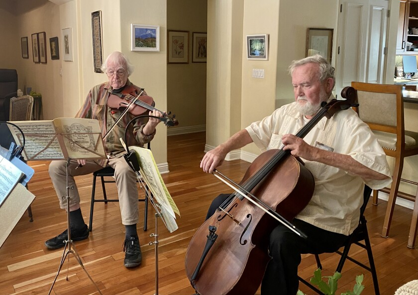 Jack Clausen (left) and Willis Frisch have played music together for more than 50 years.