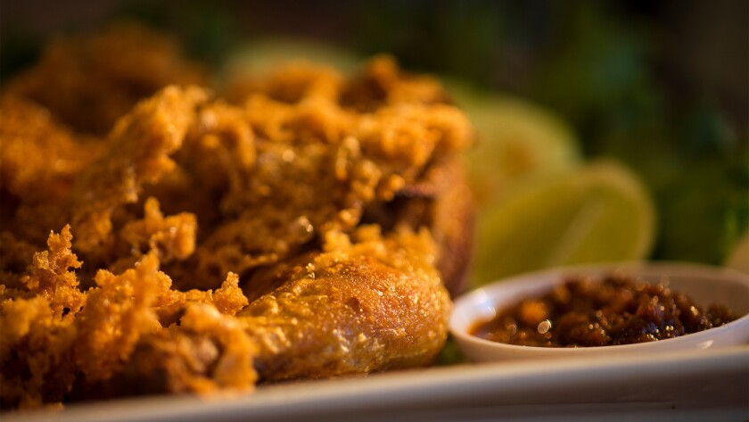 The ayam goreng kremes dish is Indonesian marinated fried chicken topped with crunchy rice-flour cru